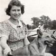 Queen Elizabeth as a young girl with one of her originals corgis