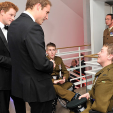 Princes William and Harry speak with soldiers at the awards