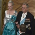Queen Margrethe and Prince Henrik enter the court ball