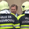 Grand Duke Henri chats with firemen who came to put out a fire at the Grand Ducal Palace