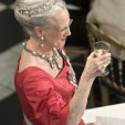 Queen Margrethe offers a toast at one of her birthday galas