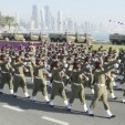 Qatari soldiers march during the Qatari National Day celebrations on December 18, 2010