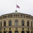 The Norwegian flag flies at half-mast atop the Norwegian Parliament building following the massacre on July 22nd, 2011