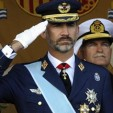 King Felipe VI salutes during the National Day military parade; 12-10-2014