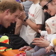 Prince Harry with baby Pippa during a walkabout in Christchurch; 12-05-2015