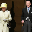 Queen Elizabeth and Prince Philip during the national anthem at the first garden party of the season at Buckingham Palace; 12-05-2015
