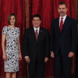 Queen Letizia, President Cartes of Paraguay and King Felipe pose for a photo before a lunch at the Royal Palace; 09-06-2015