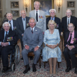 The Prince of Wales and the Duchess of Cornwall with World War II veterans at Clarence House; 10-06-2015