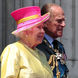 Queen Elizabeth and the Duke of Edinburgh watch a flypast to mark the 75th anniversary of the Battle of Britain; 10-07-2015