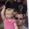 Peter Phillips manages to keep his niece Mia occupied while watching the Festival of British Eventing; 09-08-2015