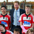 Prince Harry poses with students who play rugby during a visit to Devon; 07-10-2015