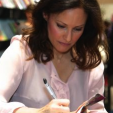 Carina signs a copy of her book at the Copenhagen Book Fair; 07-11-2015