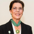 Princess Caroline wearing her new insignia for the Order of Arts and Letters