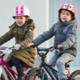 Princess Josephine and Prince Vincent riding their bicycles on the way home from kindergarten