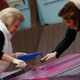Princess Beatrix and Princess Aimee get their rolling on as they paint a platform on NLdoet day