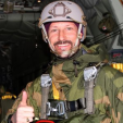 Crown Prince Haakon gives a thumbs up prior to a parachute jump
