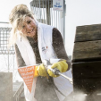 Queen Maxima gets to grip with a pressure washer during NL Doet
