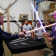 Prince Harry and Prince William partake in a lightsaber duel