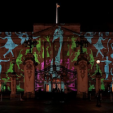 A peacock projected onto the facade of Buckingham Palace