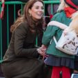 23437448-7889425-The_Duchess_of_Cambridge_smiles_as_she_holds_a_child_s_hand_duri-a-306_1579102769782