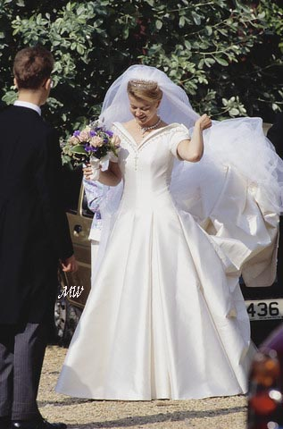 353f834215a28 ... deep v-neckline and cap sleeves were heavily embroidered with silver  diamante and pearls. image This detailing complemented the bride's  jewellery.