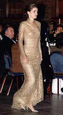 Click image for larger version  Name:Wearing_Gold_Dress.jpg Views:2088 Size:24.7 KB ID:16964
