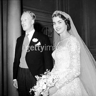 Click image for larger version  Name:Earl of Dalkeith, son of Duke of Buccleuch, with bride Jane McNeil, ex-Hartnell model 2 01-24-53.jpg Views:1744 Size:57.2 KB ID:40456